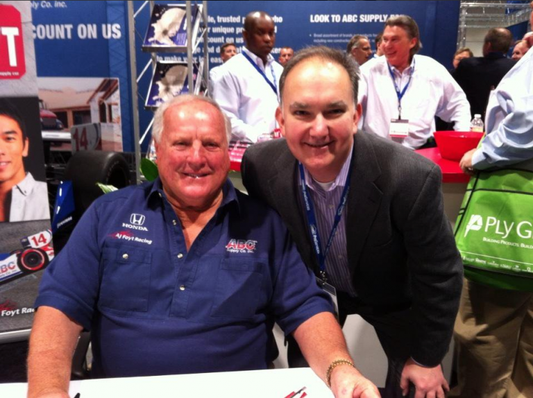 Doug Davila poses with with Indy 500 legend, A.J. Foyt. His new business development role involves networking at trade shows.