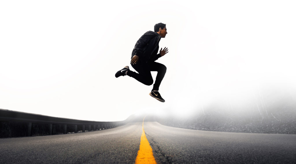 "A man wearing Nike shoes runs across a road. The ""aha!"" moment tied Nike's ""Just Do It"" campaign to athletic motivation."