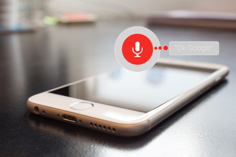 Voice-assisted devices like Google Assistant, shown here on a smart phone, are rising digital marketing trends.