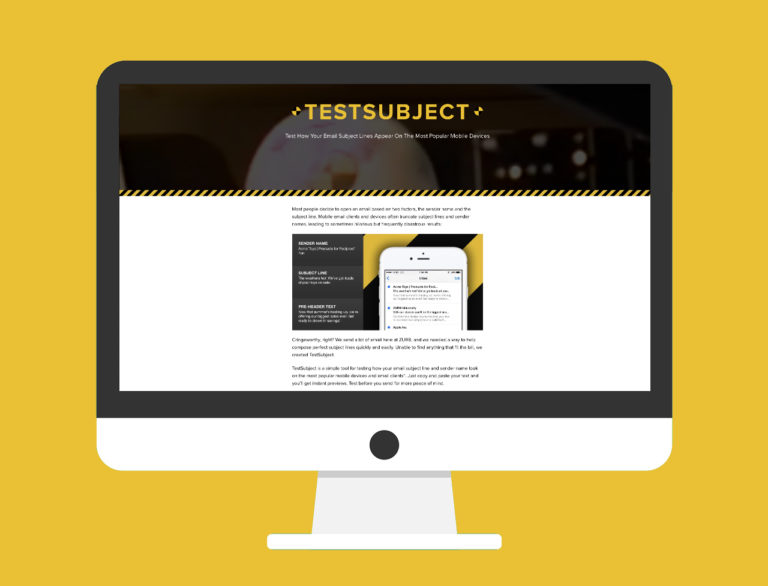 A desktop computer with Zurb's TestSubject homepage featured on the screen. TestSubject is a helpful tool for stronger business writing.