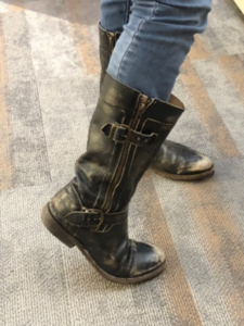 Designer footwear, like the boots shown here, is often advertised leveraging the human desire to acquire.